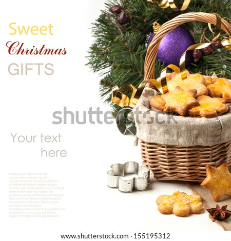 Basket of homemade sugar cookies  near christmas tree over white with sample text - stock photo