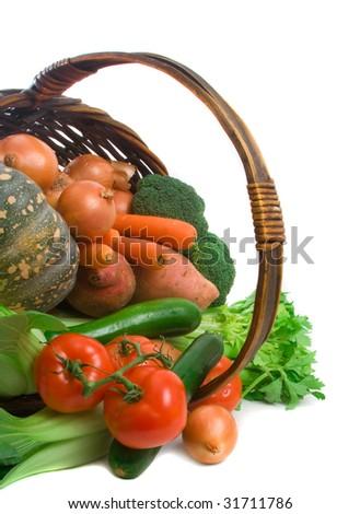 Basket of market fresh vegetables over white background - stock photo