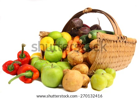 Basket of vegetables and fruits - stock photo