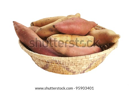 Basket of whole yams and sweet potatoes isolated on white - stock photo