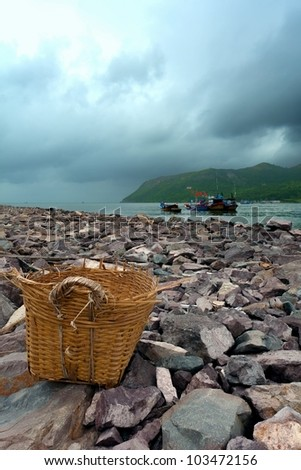 Basket on the seas and boats - stock photo