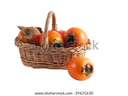 basket with a persimmon on a white background - stock photo
