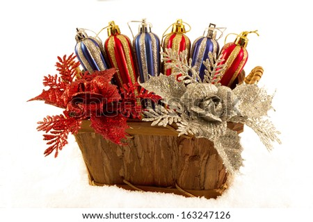 basket with Christmas toys and flowers - stock photo
