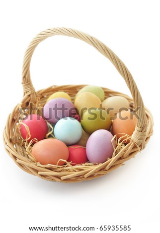Basket with colorful Easter eggs - stock photo