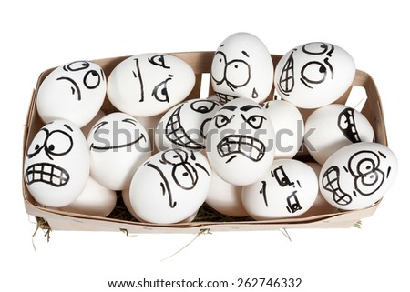 Basket with eggs which are drawn angry face isolated on white background - stock photo