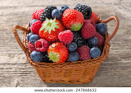 basket with fresh seasonal berries, close-up, top view - stock photo