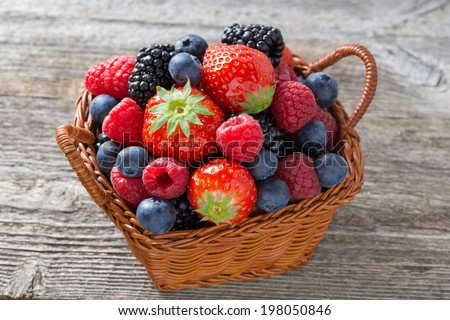 basket with fresh seasonal berries, top view, close-up - stock photo
