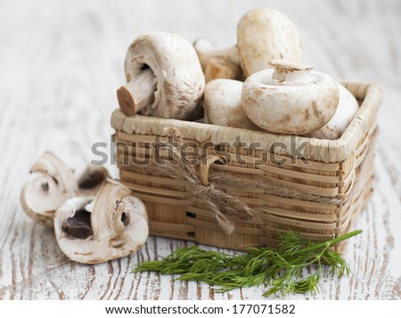 Basket with mushrooms on a wood table - stock photo
