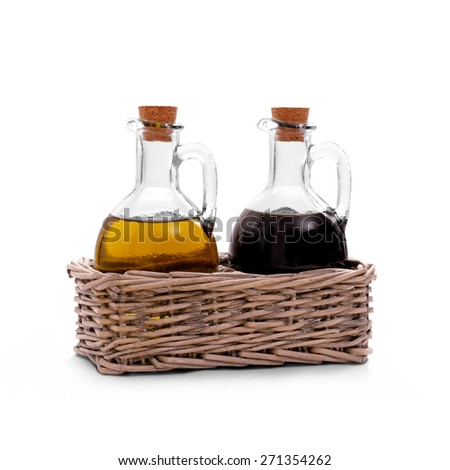 Basket with olive oil, Italian balsamic vinegar of Modena, isolated - stock photo