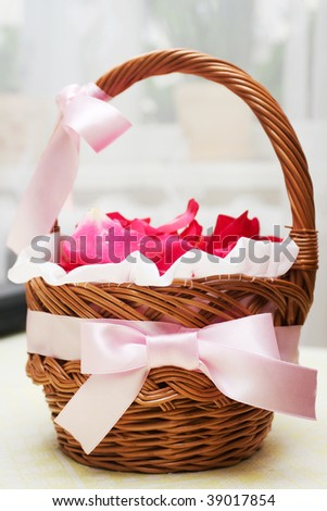 Basket with roses petals - stock photo