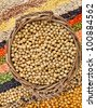 basket with soybeans on the background of the striped rows of lentils, beans, peas, grain, legumes, seed - stock photo