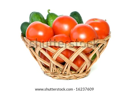Basket with tomatoes and cucumbers isolated on the white background