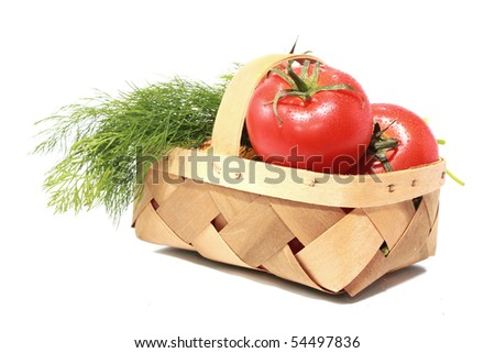 Basket with tomatoes and dill