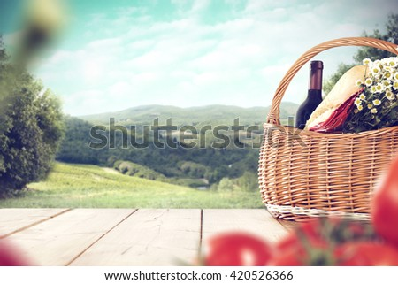 basket with wine and table
