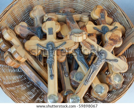 Basket with wooden crosses for sale. - stock photo