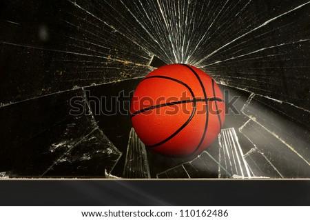 Basketball and broken window. - stock photo