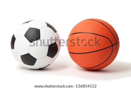 Basketball and football balls isolated on white - stock photo