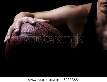 Basketball ball in a hand of the basketball player