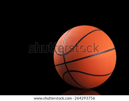 Basketball ball on black background - stock photo