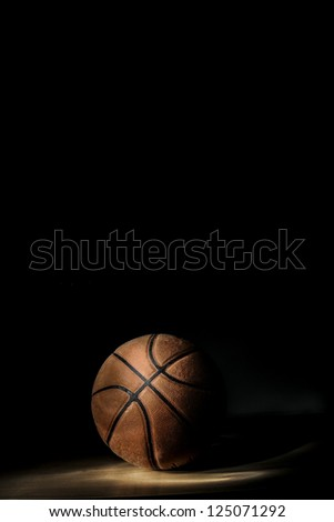 Basketball ball on black background, with room to add your text (light painting technique) - stock photo
