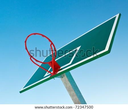 Basketball basket over blue sky - stock photo