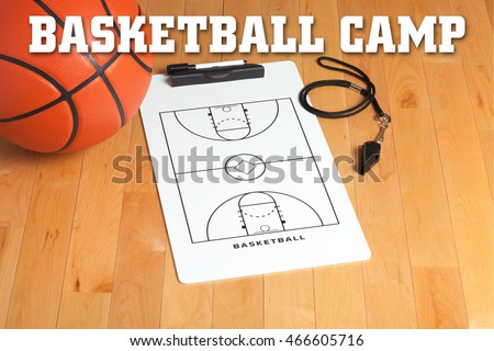Basketball camp letters on background of a wooden floor with coach's clipboard