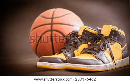 Basketball court with ball and shoes - stock photo
