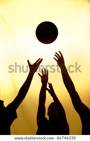 Basketball fight - black silhouettes of players - stock photo