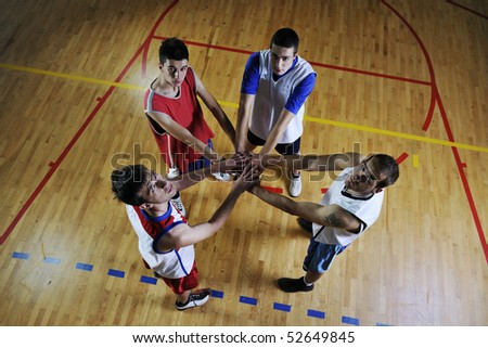 basketball game players holding together as team representing team spirit - stock photo