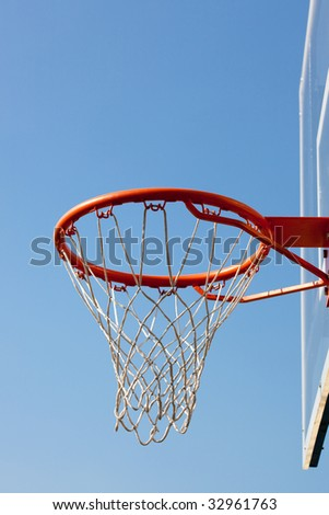 Basketball hoop against blue skies with backboard. Concept shot of aim, destination, goal, target - stock photo