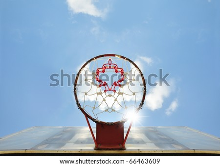basketball hoop against blue sky bottom view - stock photo