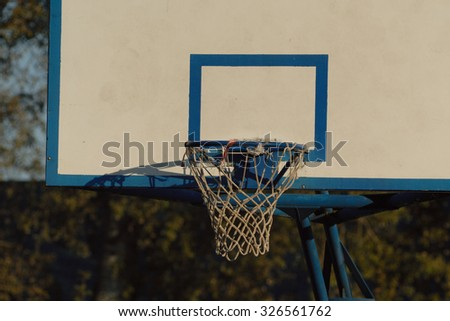 Basketball hoop during sunset. - stock photo