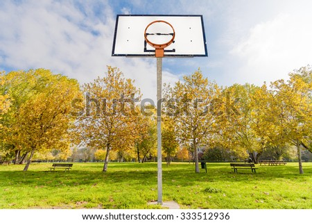 Basketball hoop in the city park in autumn