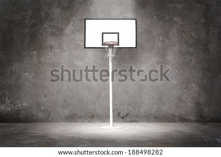 Basketball hoop on a textured wall - stock photo