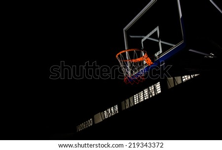 Basketball hoop on  black background with light effect - stock photo