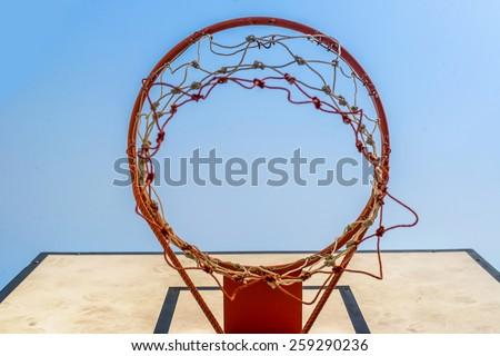 Basketball hoop under  blue sky - stock photo