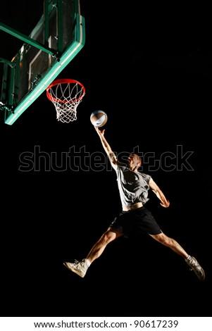 Basketball jump isolated on black background - stock photo