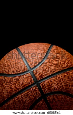 Basketball on black background with copy space - stock photo