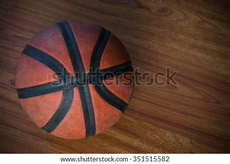 basketball on court or wooden, popular sport with team, sport background and empty area for text. - stock photo