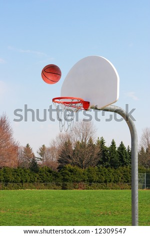 Basketball on the way to score - stock photo