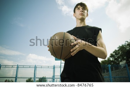 basketball outside (special toned photo f/x, focus point on ball,special vignetting) - stock photo