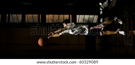Basketball player chasing the ball - stock photo