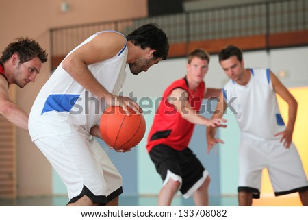 Basketball player dribbling - stock photo
