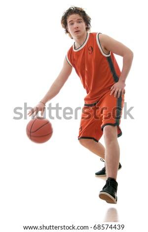 Basketball player dribbling the ball. - stock photo