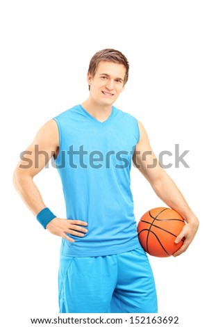 Basketball player holding a ball and looking at camera isolated on white background - stock photo