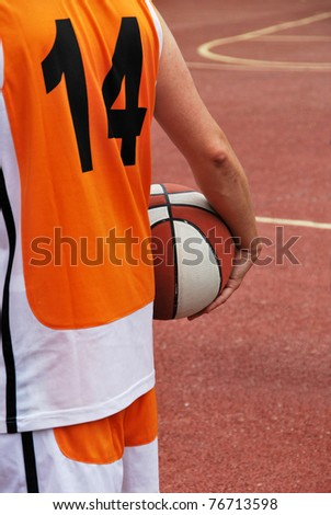 Basketball player holding the ball, fourteen number - stock photo