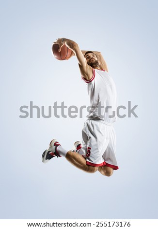 Basketball player in action isolated on white - stock photo