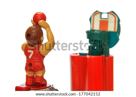 Basketball player shooting toy on white background