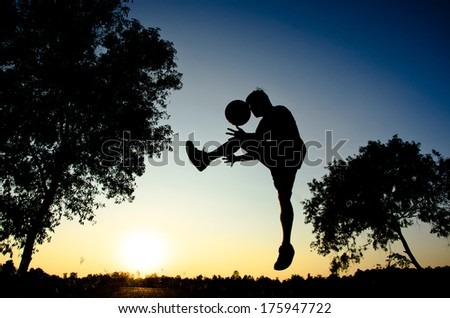 Basketball player silhouette sunset background as sport concept