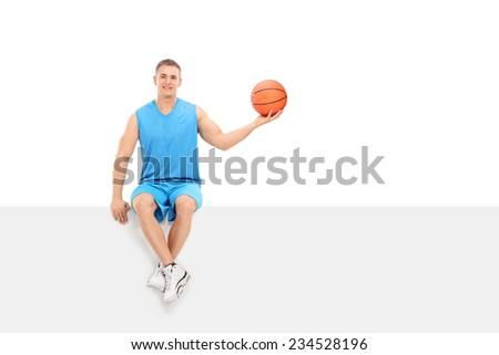 Basketball player sitting on a blank billboard isolated on white background - stock photo
